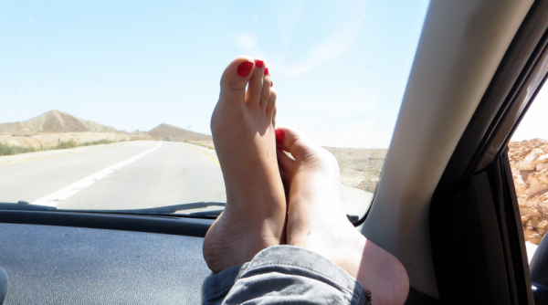 Do not place feet on the dashboard, it is extremely dangerous