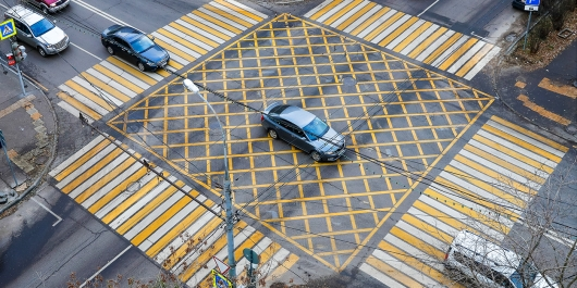 Cameras at intersections with waffle markings have begun to send fines to drivers