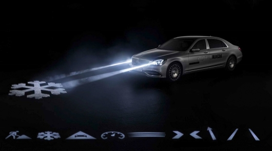 Headlights Mercedes learned to show the label and beyond: video