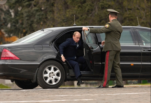 Why protection of Putin holding the car door?